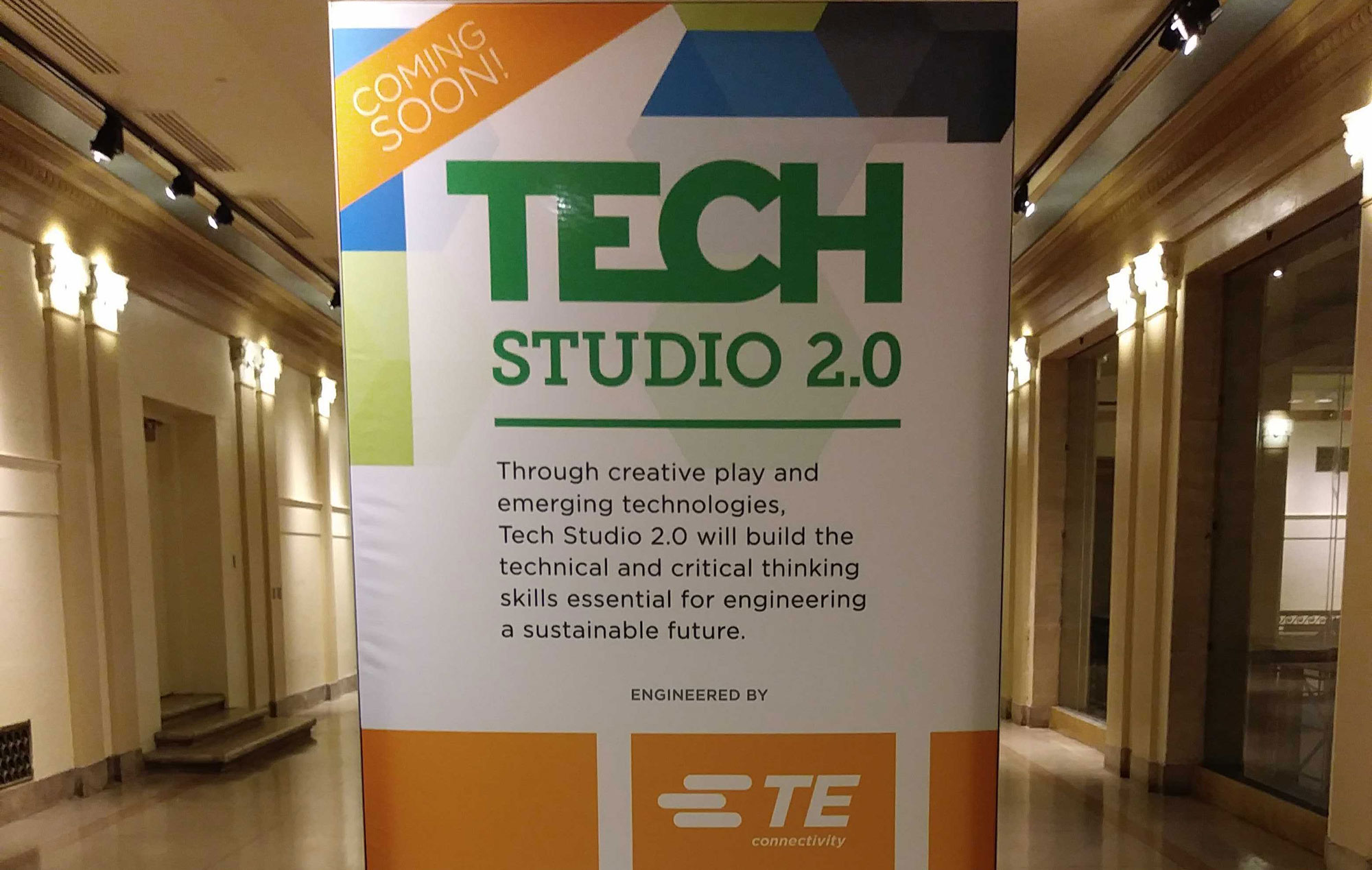 """A banner in The Franklin Institute reads, """"Tech Studio: Coming Soon. Engineered by TE Connectivity."""""""