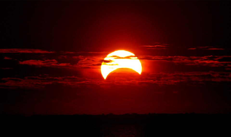 Partial Solar Eclipse occurring at sunrise