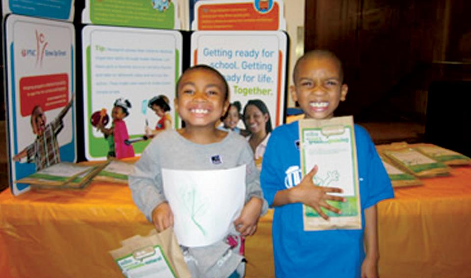 Two young boys very happy with their take-home activities from Community Night by The Franklin Institute.