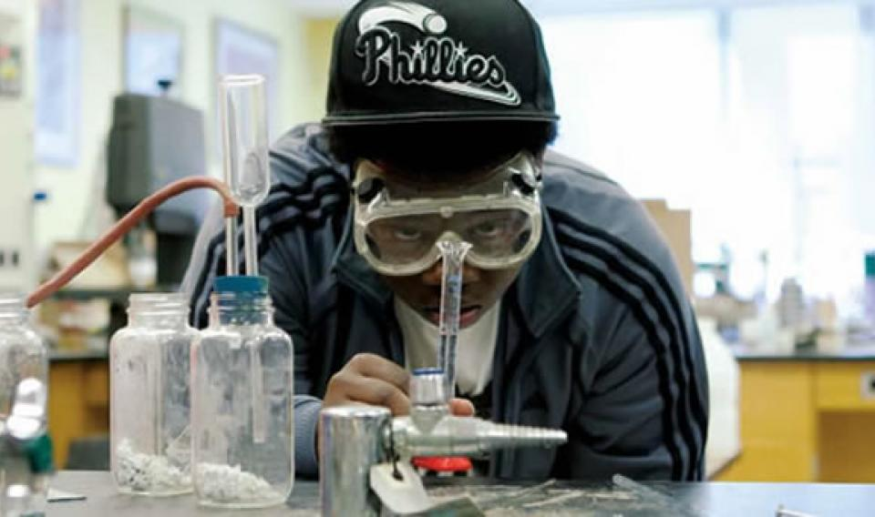 A youth conducting a scientific experiment as part of The Franklin Institute's PACTS program.
