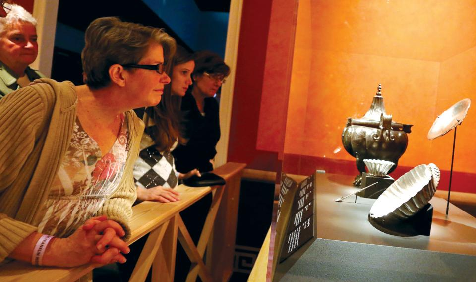Educators looking at a collection of artifacts at the Franklin Institute.