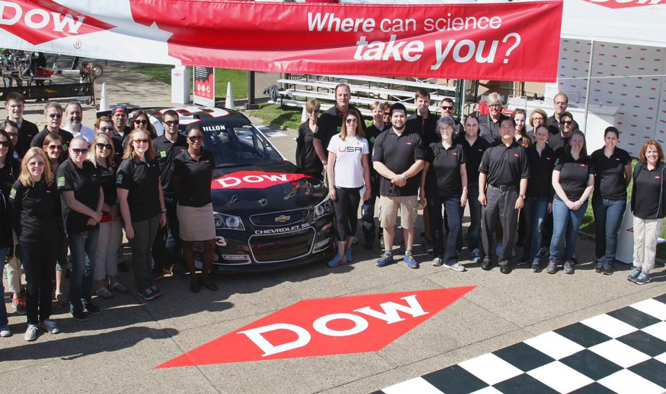 Image of race car at finish line and team from Dow