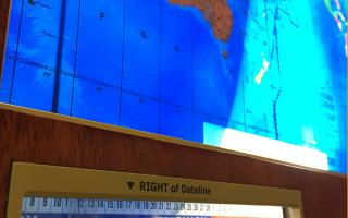 Mechanical Geochron Clock shows areas of day and night overlaid on a backlit map of the world.