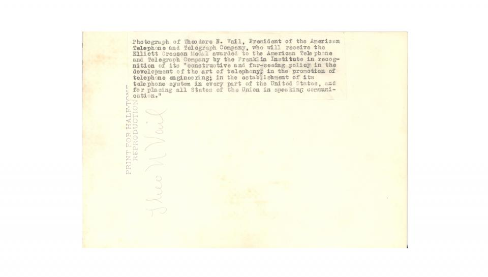 Back of Photograph: Reverse side of the Vail photograph, including a sticker detailing AT&T's qualifications for the Cresson Medal