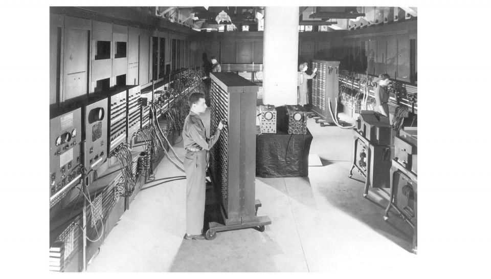 ENIAC engineers working carefully to program the machine in the 1940s.