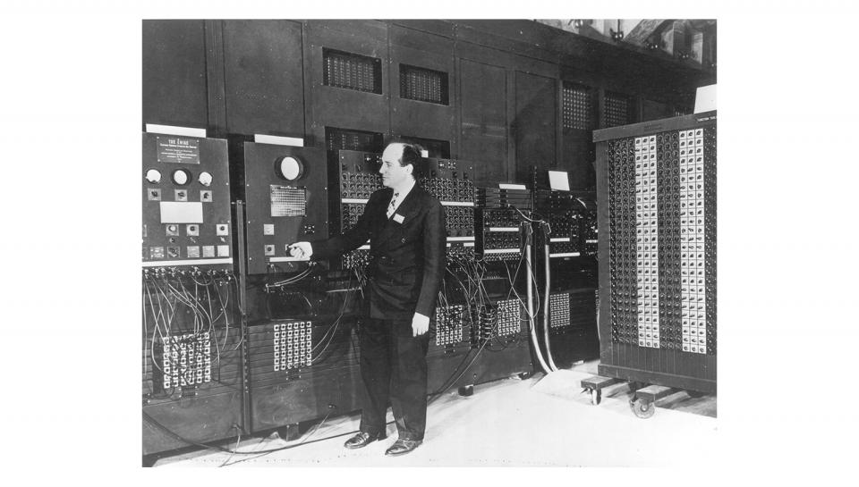 February of 1946 found Presper Eckert standing at the console of the ENIAC.