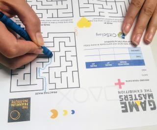 hands completing a maze puzzle